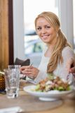 Young Woman Having Food At Coffeeshop Royalty Free Stock Photography