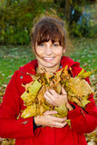 Young woman having fun in autumn Stock Photos