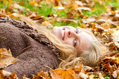 Young woman having fun in autumn Royalty Free Stock Photography