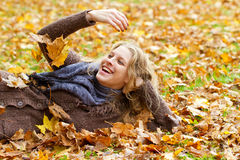 Young woman having fun in autumn Royalty Free Stock Photos