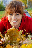 Young woman having fun in autumn Royalty Free Stock Image