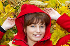 Young woman having fun in autumn Stock Photography