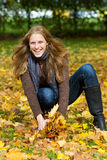Young woman having fun in autumn Stock Image