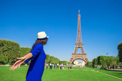 Young woman having fun background Eiffel Tower in Stock Images