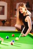 Young woman having fun with billiard. Stock Photos