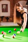 Young woman having fun with billiard. Royalty Free Stock Photo