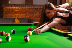 Young woman having fun with billiard. Stock Photography