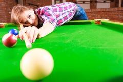 Young woman having fun with billiard. Stock Photo