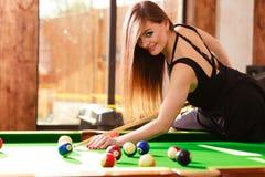 Young woman having fun with billiard. Royalty Free Stock Image