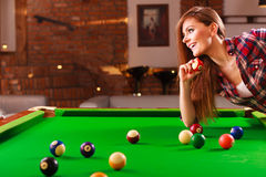 Young woman having fun with billiard. Royalty Free Stock Photography