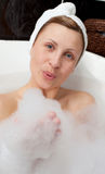 Young woman having fun in a bubble bath Royalty Free Stock Photo