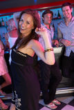 Young Woman Having Fun In Busy Bar. Young Woman Having Fun Dancing A In Busy Bar royalty free stock photography
