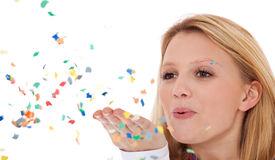 Young woman having fun with confetti Royalty Free Stock Images