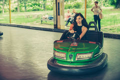 Young woman having fun in electric bumper car Royalty Free Stock Image