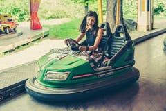 Young woman having fun in electric bumper car Stock Photography