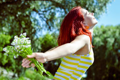 Young woman having fun on green summer outdoors Royalty Free Stock Images