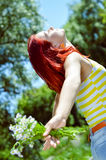 Young woman having fun on green summer outdoors Stock Photos
