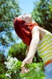 Young woman having fun on green summer outdoors Stock Photos