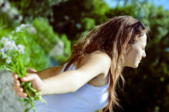 Young woman having fun on green summer outdoors Stock Photography