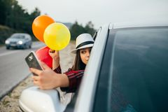 Happy woman with baloons traveling stock photography