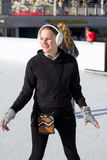 Young Woman Having Fun While Ice Skating Royalty Free Stock Photography