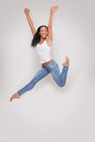 Young woman having fun jumping in studio Royalty Free Stock Photos