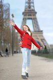 Young woman having fun near the Eiffel tower Stock Images