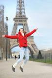 Young woman having fun near the Eiffel tower Stock Photo