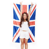 Young woman having fun next the Union Jack flag Stock Image