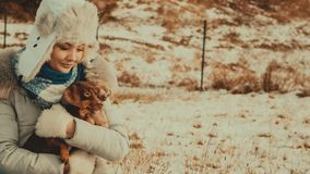 Woman playing with dogs during winter royalty free stock photography