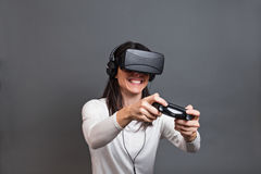 Young woman and having fun playing a virtual reality video game Royalty Free Stock Photos