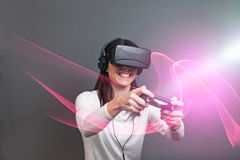 Young woman and having fun playing a virtual reality video game Royalty Free Stock Images