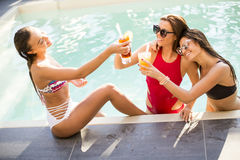 Young woman having fun by the pool Stock Image