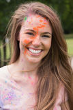 Young woman having fun with powder paint Royalty Free Stock Image