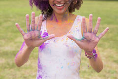 Young woman having fun with powder paint Royalty Free Stock Photo