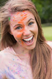 Young woman having fun with powder paint Royalty Free Stock Photos