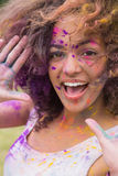 Young woman having fun with powder paint Royalty Free Stock Images