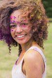 Young woman having fun with powder paint Stock Photos