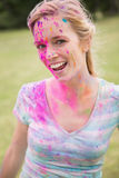 Young woman having fun with powder paint Stock Image