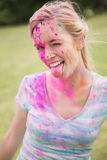Young woman having fun with powder paint Stock Photo