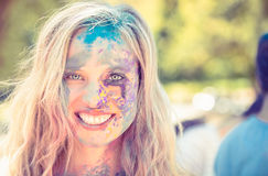Young woman having fun with powder paint Royalty Free Stock Photography