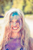 Young woman having fun with powder paint Stock Photography