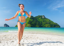 Young woman is having fun on sandy beach Stock Photo