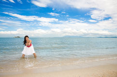 Young woman having fun by the sea Royalty Free Stock Photo