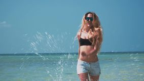 Young Woman Having Fun by Shallow Tropical Sea. Shot with a Sony a6300 fps29,97 4k stock footage