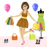 Young woman having fun with shopping bags over women's clothes Stock Images