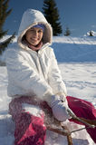 Young woman having fun with sled Stock Photos