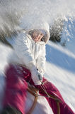 Young woman having fun with sled Royalty Free Stock Images