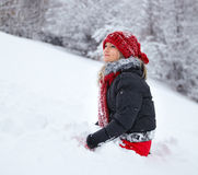 Young woman having fun in the snow Stock Image