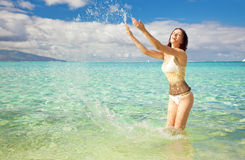 Young woman having fun splashing water Stock Photography